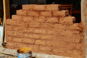 mudbrick wall waiting for shaping of half-bricks