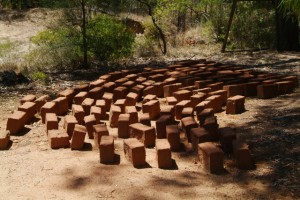 mudbricks drying, waitiug to be stacked
